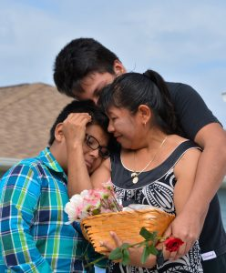 picture-5-a-family-is-overcome-with-emotion-and-gratitude-at-their-habitat-for-humanity-home-dedication-ceremony-in-immokalee-web